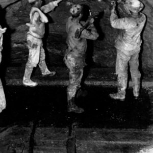 Miners underground advancing a drift at the Empire Mine