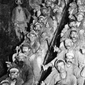 A shift of miners ascends in skips after a work tour. Many of these miners were Cornishmen -- 'Cousin Jacks.'