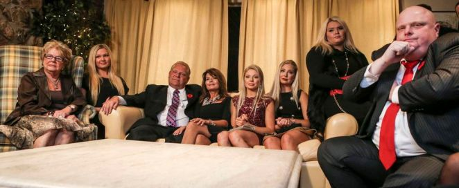 Doug Ford sits with his mother Diane, left, and his wife Karla and all four of his daughters, plus Rob Ford, in the Ford family basement during the Toronto mayoral election on Oct. 27, 2014.