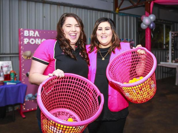 Cobie Hoycard and Pip Casserly at the Bra Pong stalll.