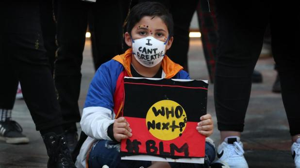 Seven-year-old Reginald Jones at the the black lives matter rally in Forrest Chase, Perth.PICTURE NIC ELLIS THE WEST AUSTRALIAN