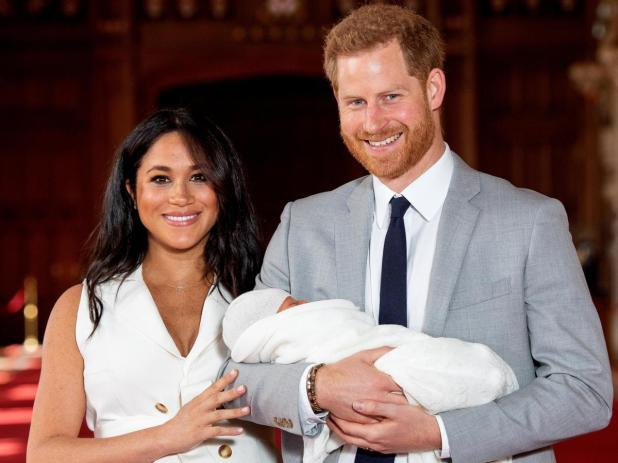 Meghan and Harry with their newborn son Archie.