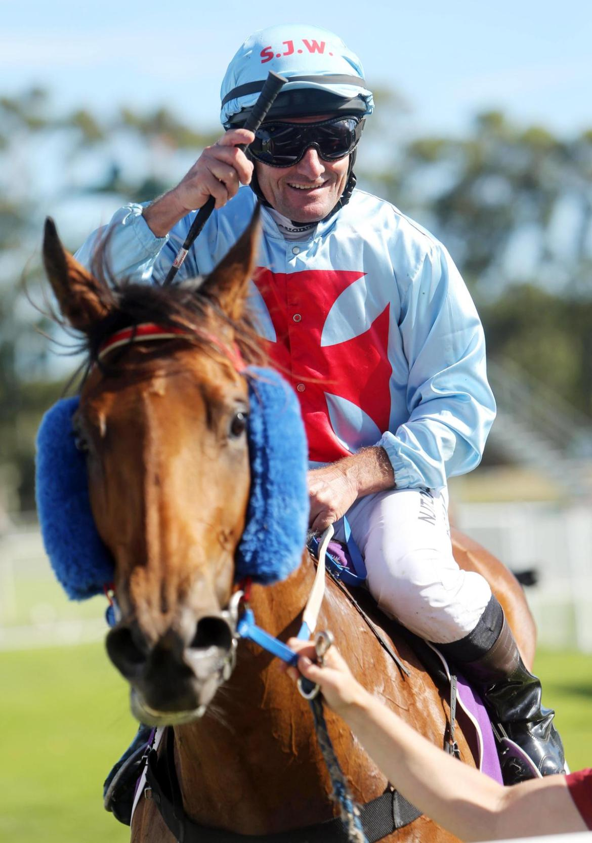 Peter Hall is all smiles as he brings the Steve Wolfe-trained Alpha And Omega back to scale after winning the Scenic Lodge Handicap (1100m).