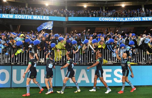 New South Wales players react with Perth rugby fans at Optus Stadium.