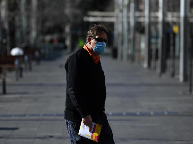 A pedestrian wearing a face mask in the central business district in Sydney.