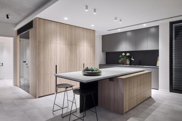 The minimalist-style kitchen boasts a combined scullery and laundry directly behind it, keeping any mess hidden.