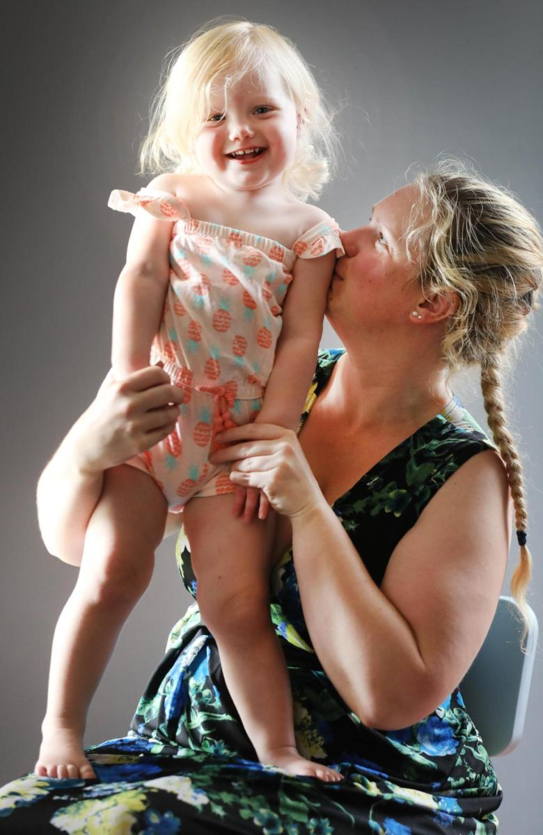 A recovered Maddison with her mother Kelly Lovegrove.