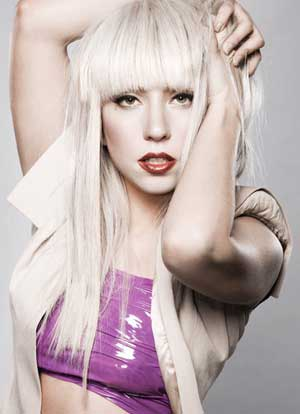 Lady Gaga's long yellow blonde hairstyle with curls,