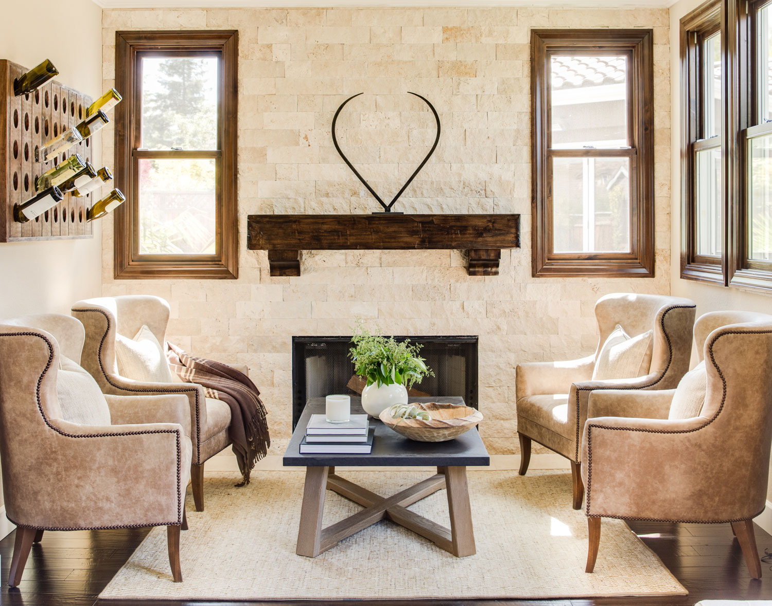 wine country living room style ideas 2017 home dressed in neutrals traditional stone walls a wooden mantel nubby rug and wing chairs upholstered luxurious faux leather infuse the s second sitting area with texture