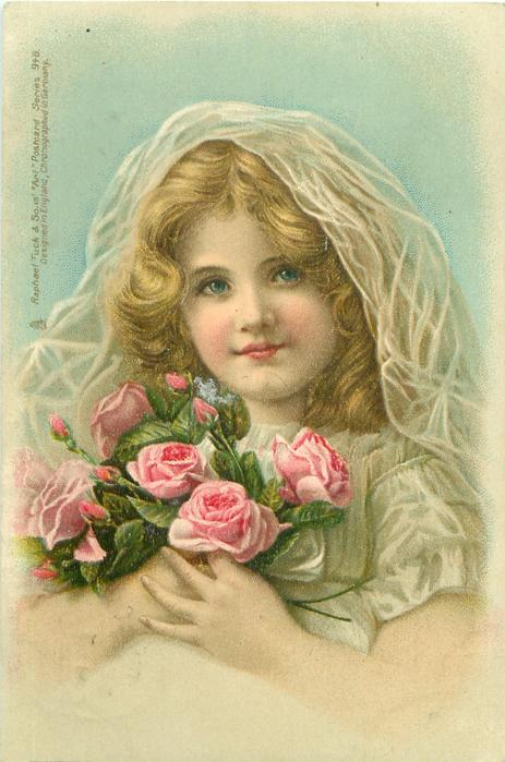 Blond Child In White Dress With Veil Over Hair Holds Pink
