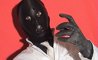 Man wearing a black hockey mask with a necktie