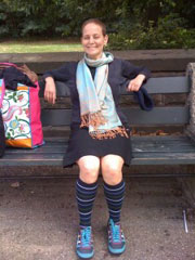 Dara Greenwald sitting on a park bench