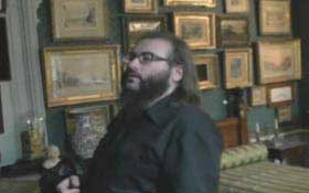 Steven Johnson Leyba looking at paintings in a museum