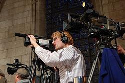 Cameraman lining up a shot