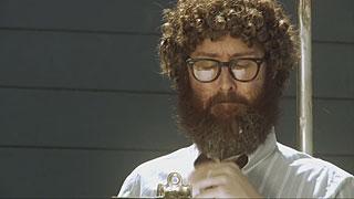 Man brushing crumbs out of his beard