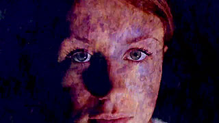 Close-up of a woman with an abstract image projected on her face
