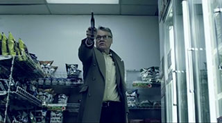 Retired police detective pointing a gun in a convenience store