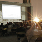 Audience watching a movie on a rooftop