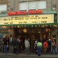 Exterior marquee of the Somerville Theatre with crowd lined up beneath it