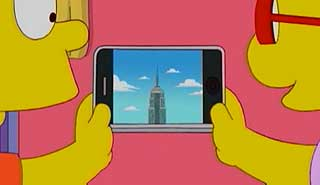 Bart Simpson and Milhouse watch the Empire State Building on an iPhone