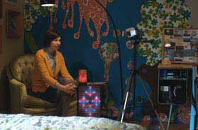 Carrie Brownstein talking to a video camera