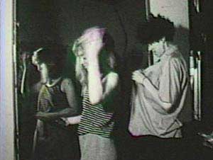 Film still from Baby Doll by Tessa Hughes-Freeland featuring two women beginning to undress