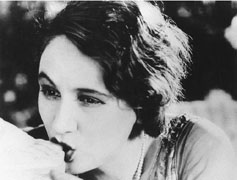 Film still from L'Age d'Or of a woman kissing a statue's foot