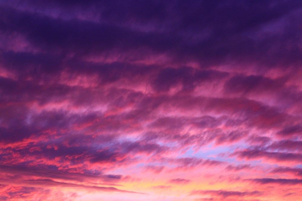 Purple and pink cloudy sky photo by Jeremy Bishop