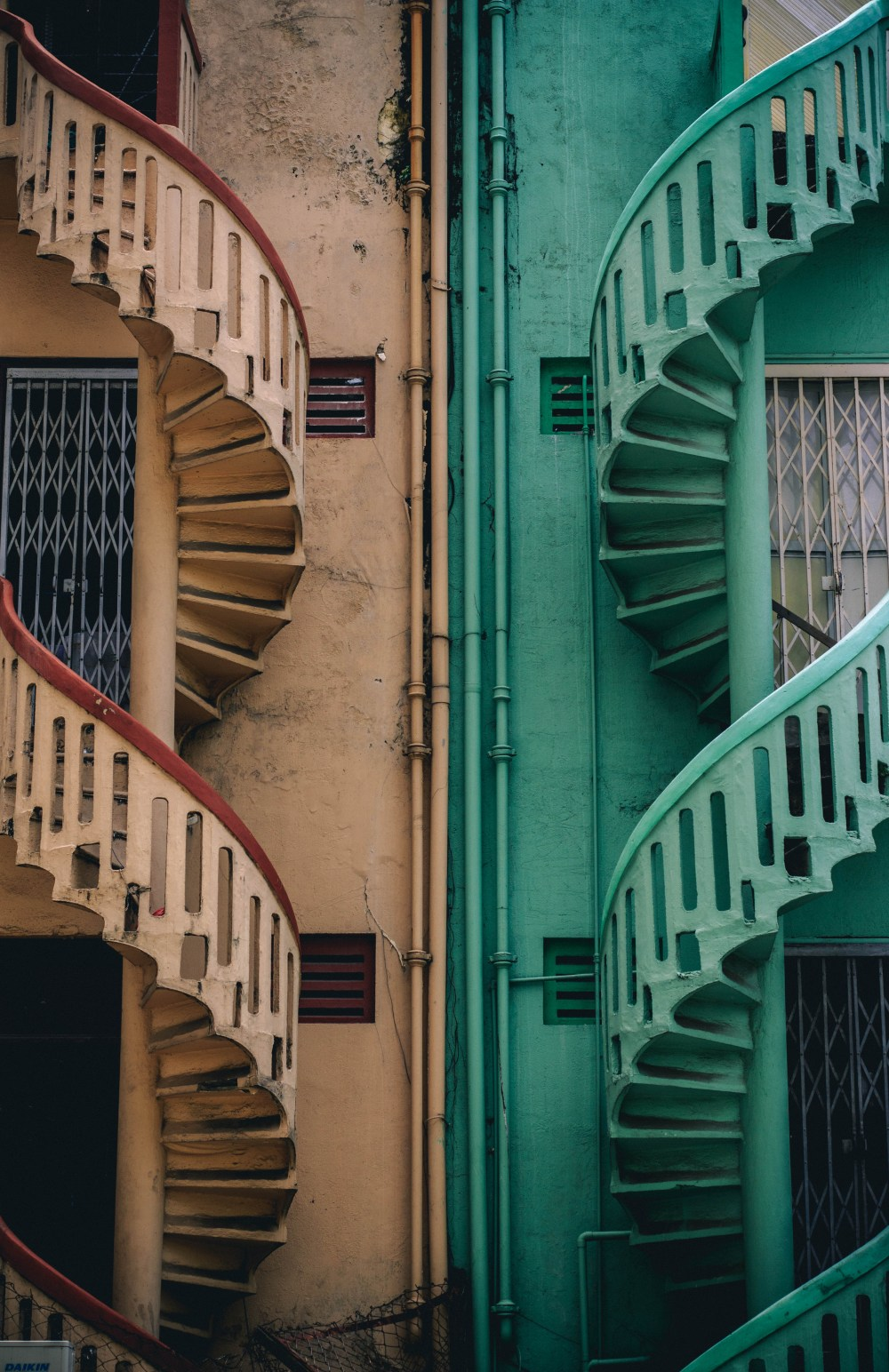 hight resolution of beige and green concrete spiral stairs beside building