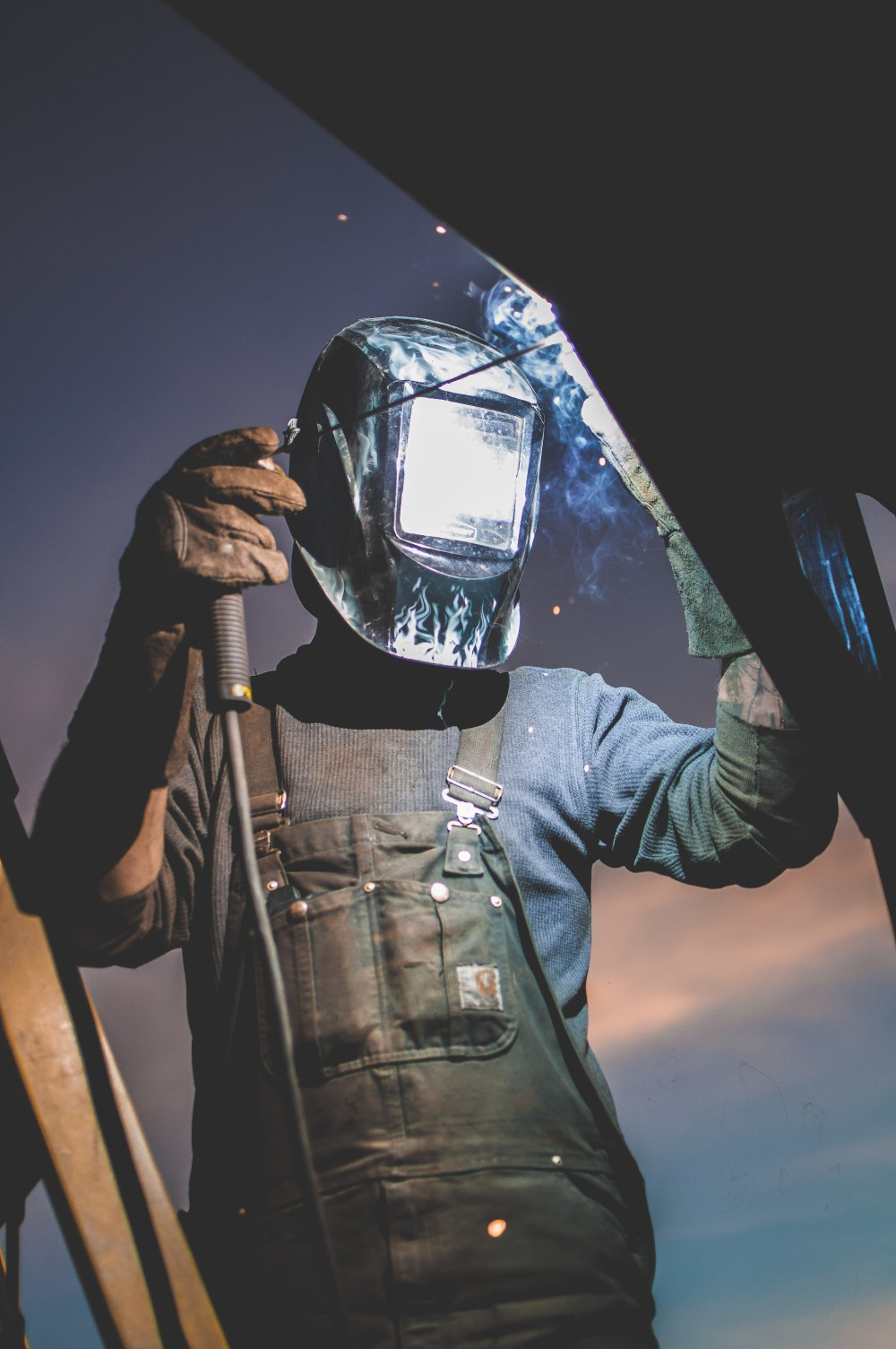 hight resolution of man wearing automatic dark welding helmet
