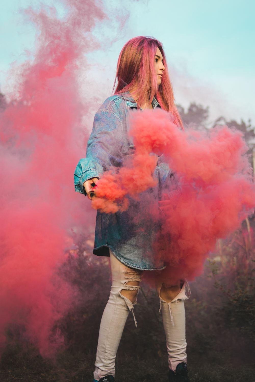 Gas Mask Girl Wallpaper Woman Holding Red Smoke Photo Free People Image On Unsplash