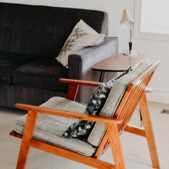 Chair Photo Frame Hd Folding Kneeling Mid Century Decor And Home By Jacalyn Beales Gray Armchair With Brown Wooden On Beige Area Rug