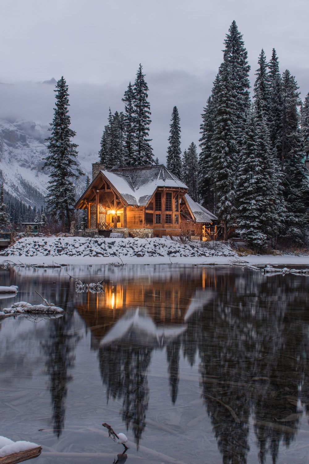 Falling Skies Wallpaper 1920x1080 Wooden House Near Pine Trees And Pond Coated With Snow