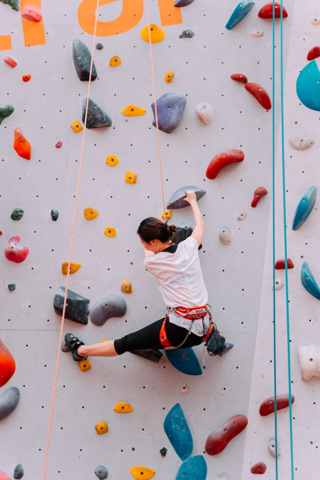 Woman Climbing On Wall During Daytime Photo Free Sport
