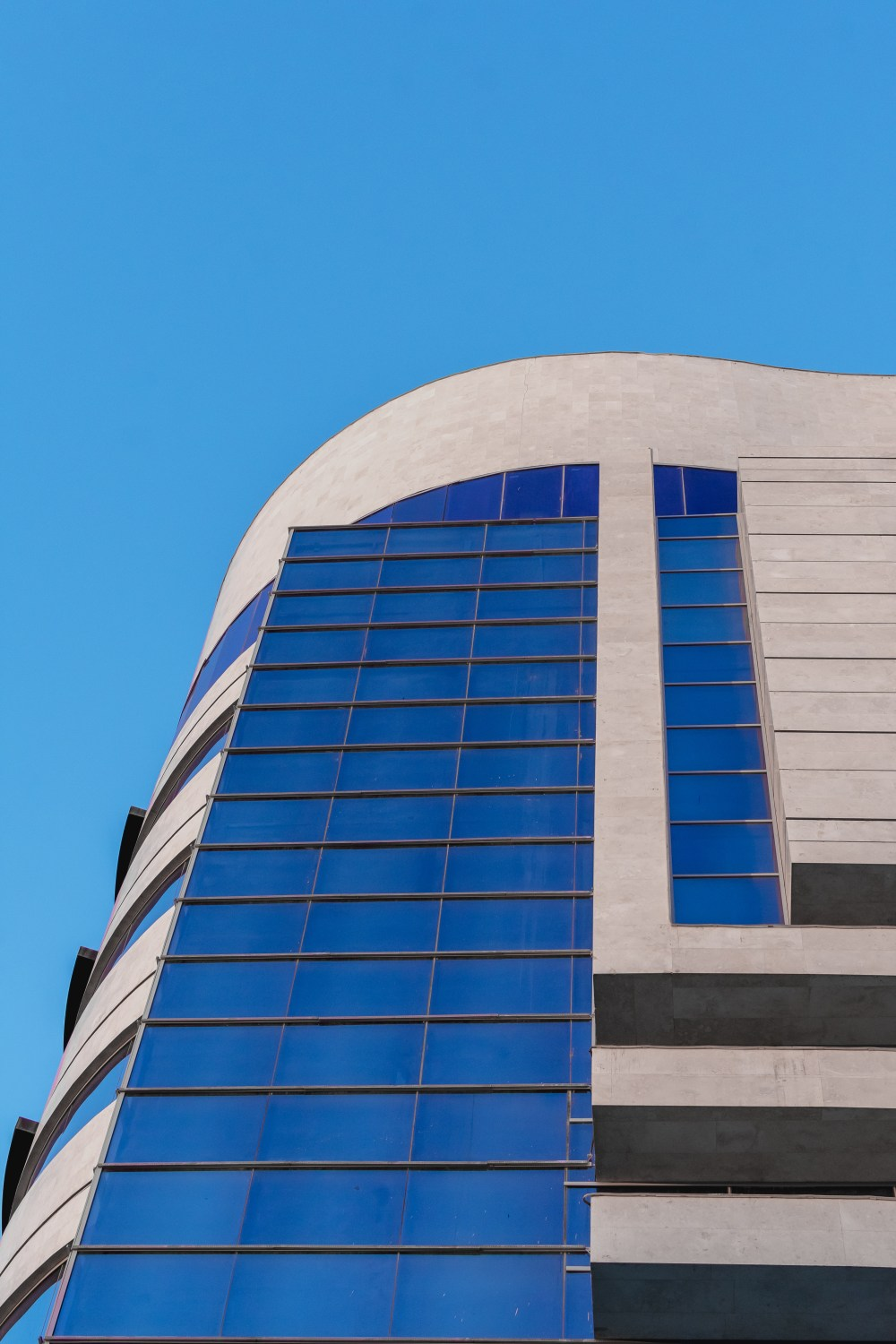 hight resolution of low angle photography of gray and blue concrete building