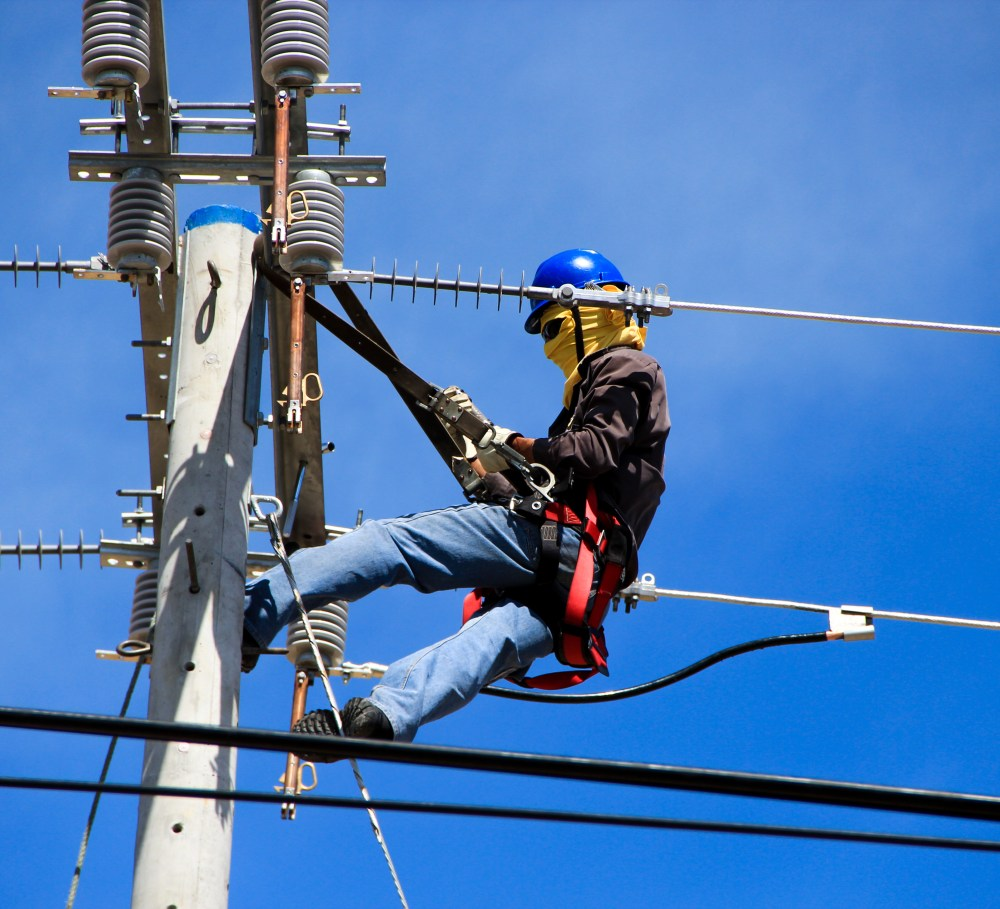 medium resolution of selective photography of electrician on electric pole during daytime