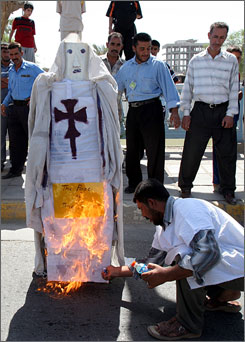 Iraqis burn an effigy of Pope Benedict XVI during a demonstration Monday in Basra, Iraq's second-largest city.