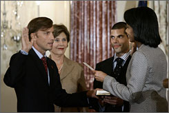 Secretary of State Condolezza Rice, swears in Mark A. Dybul, as the new coordinator of the U.S. Global AIDS office.