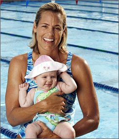 Dara Torres, 41 year old Olympic Swimmer, with child