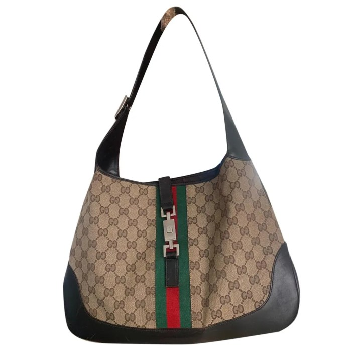 Jackie Vintage Cloth Bag from Gucci, with brown leather and monogrammed pattern with a red and green stripe and buckle across it.