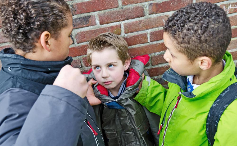 https://i0.wp.com/images.wisegeek.com/boy-child-being-bullied-by-two-other-boys.jpg?w=1060