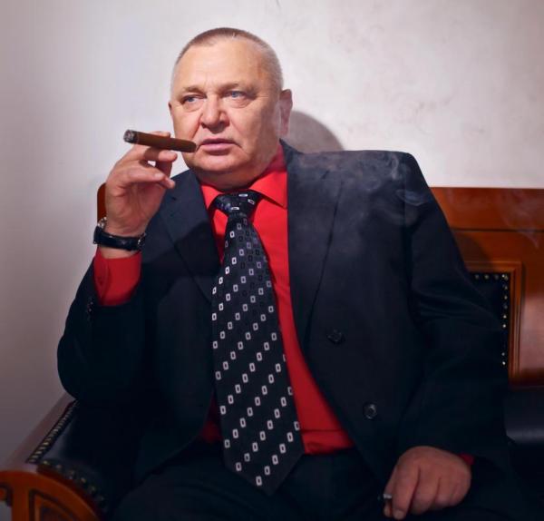 Business Man in Suit Smoking Cigar