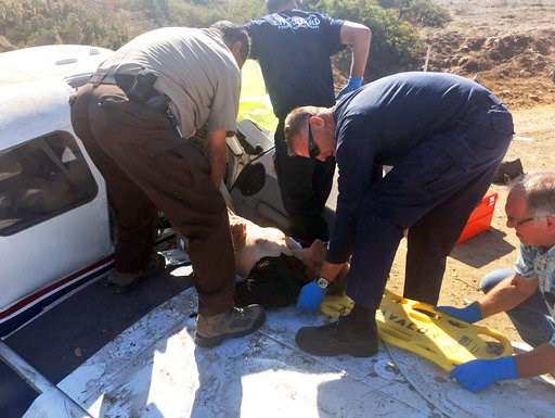 (Los Angeles County Sheriff's Department via AP). This photo provided by the Los Angeles County Sheriff's Department shows first responders extricating one of the injured from a plane that crashed at the airport near Avalon on Santa Catalina Island off...