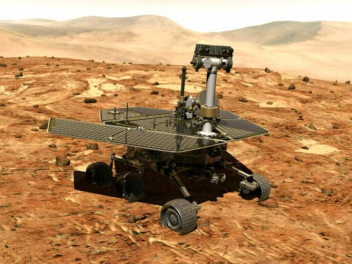 (NASA via AP). FILE - This illustration made available by NASA shows the rover Opportunity on the surface of Mars. The exploratory vehicle landed on Jan. 24, 2004, and logged more than 28 miles (45 kilometers) before falling silent during a global dust...