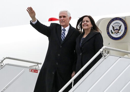 (AP Photo/Michael Sohn). United States Vice President Mike Pence and his wife Karen Pence arrive at the airport in Warsaw, Poland, Wednesday, Feb. 13, 2019. The Polish capital is host for a two-day international conference on the Middle East, co-organi...