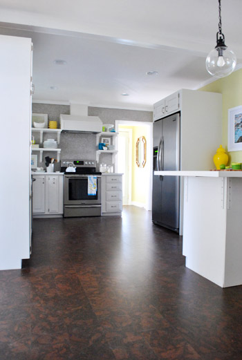 cork floor kitchen dark wood cabinets completing our s installation young house love as for plan with the variety of mismatched floors that surround freshly corked and laundry room we re huge fans flooring looks