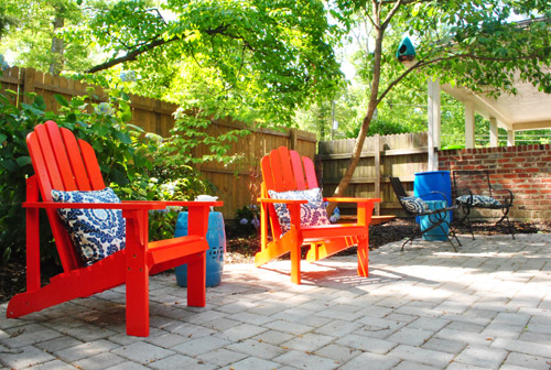 red adirondack chairs electric recliner chair power supply adding bright to our side patio young house love we even invited john s parents over see them it was a full on viewing party for there oohing ahhing sitting petting
