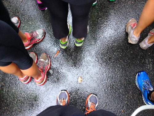 runners feet awaiting race start on wet ground richmond half marathon