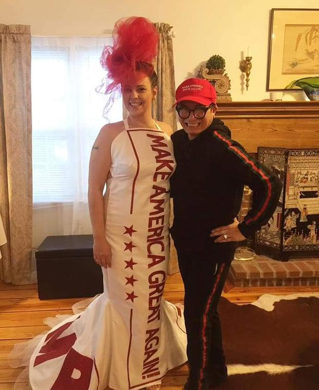 "Bride Audra Johnson poses with Andre Soriano, who designed her ""Make America Great Again"" wedding dress. Johnson married a Marine Iraq War veteran. (Courtesy Jeff Johnson)"