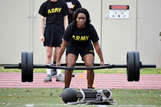 An Army staff sergeant completes a deadlift repetition during the U.S. Army Japan 2020 Army Week's Army Combat Fitness Test Fitness Warrior Competition.